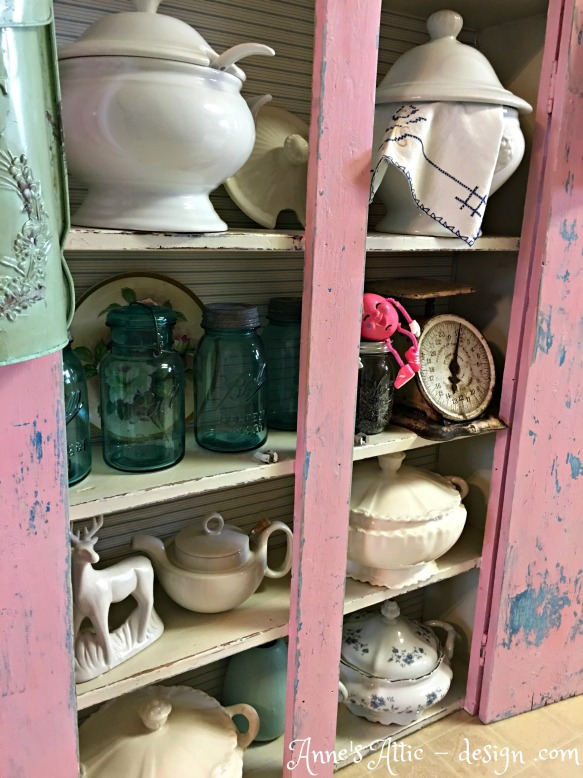 shelves in pink cupboard
